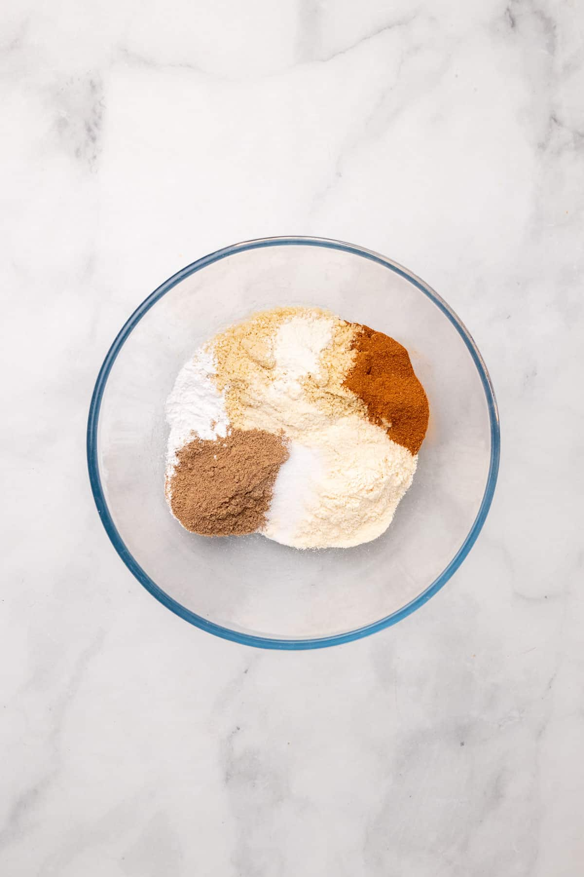 Dry ingredients in a glass bowl, unmixed