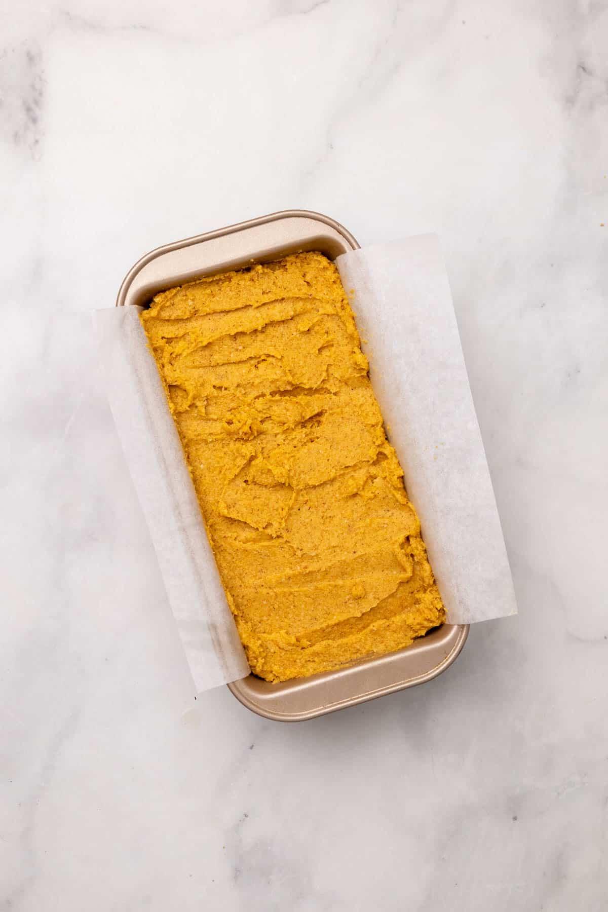 Unbaked pumpkin bread batter in the loaf pan