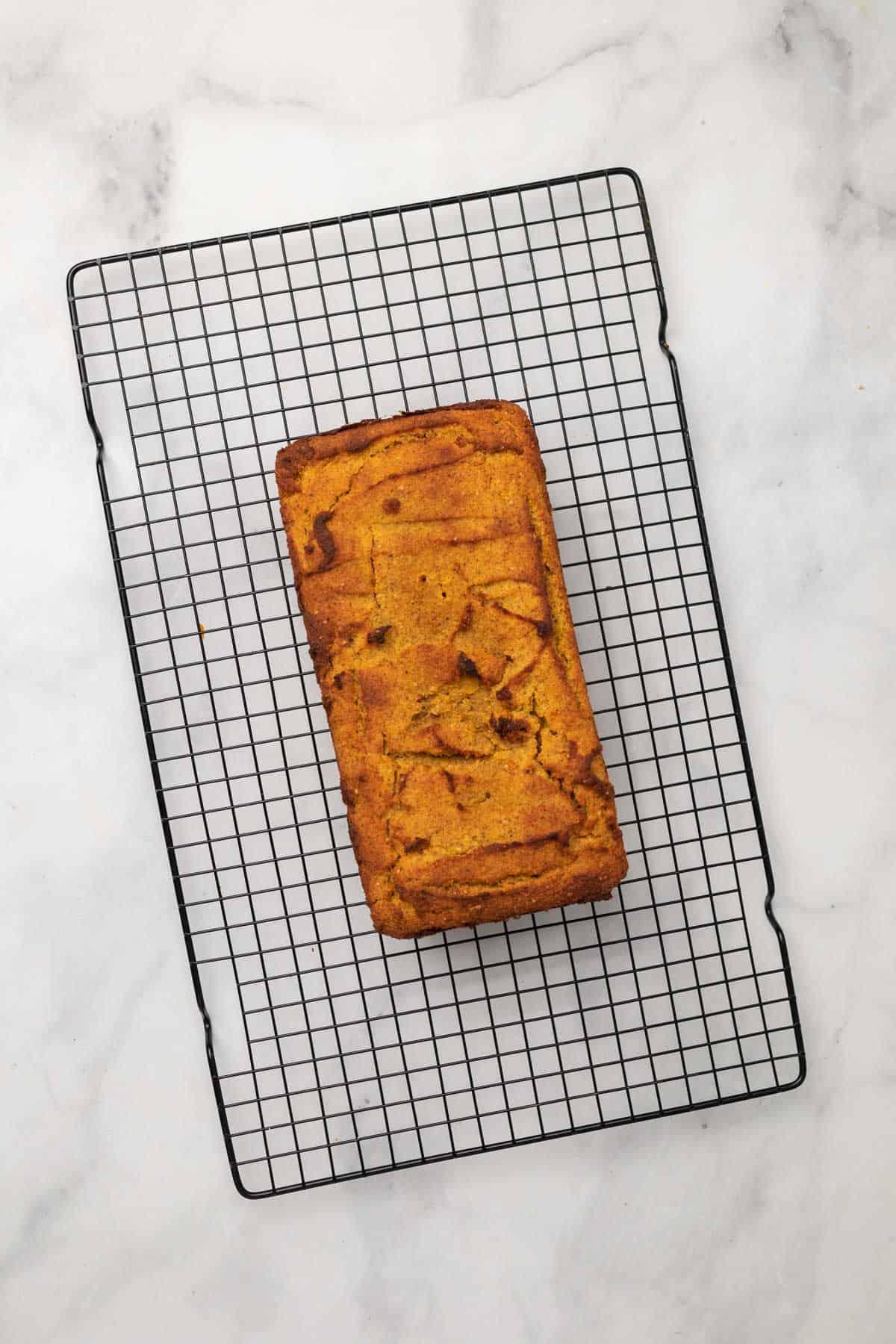 Pumpkin loaf on a cooling rack