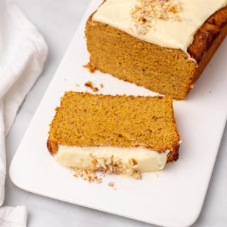 Loaf of pumpkin bread with slice