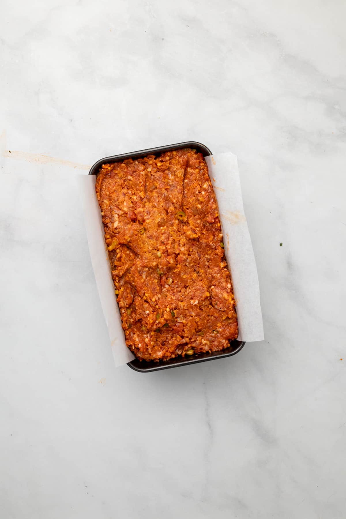 Meatloaf mixture pressed into the loaf pan