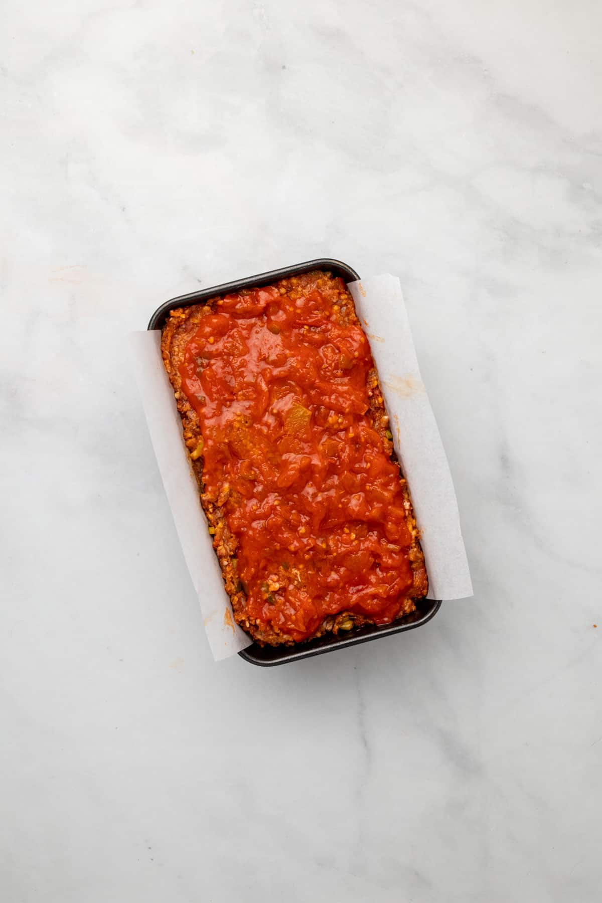Meatloaf topped with salsa