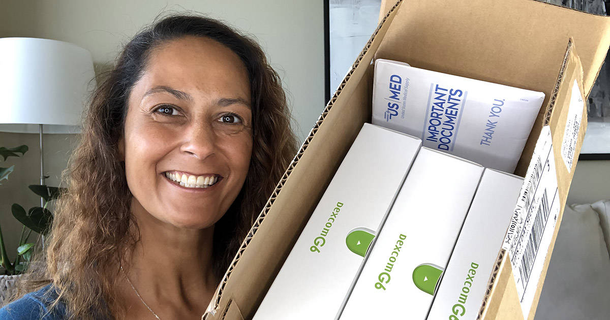 Christel holding box of diabetes products from US MED