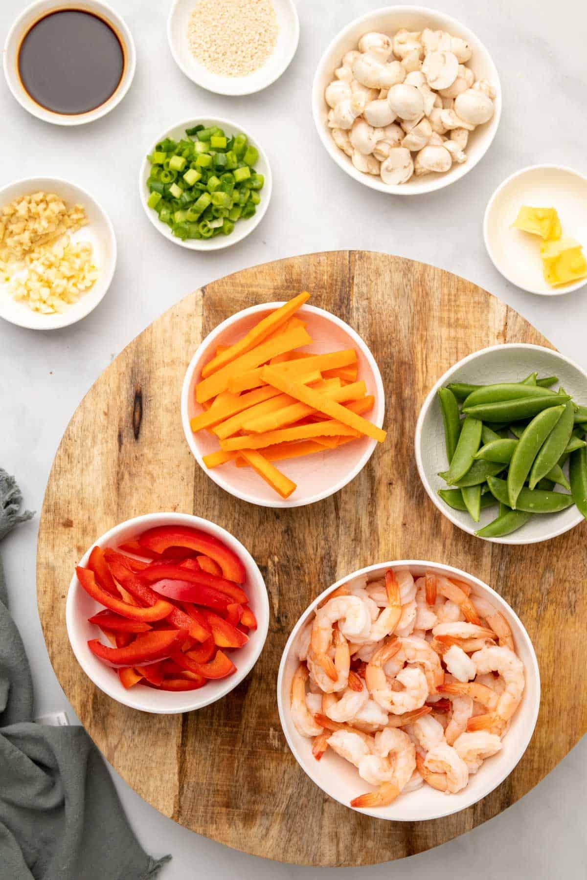 Stir fry ingredients in separate ramekins, as seen from above