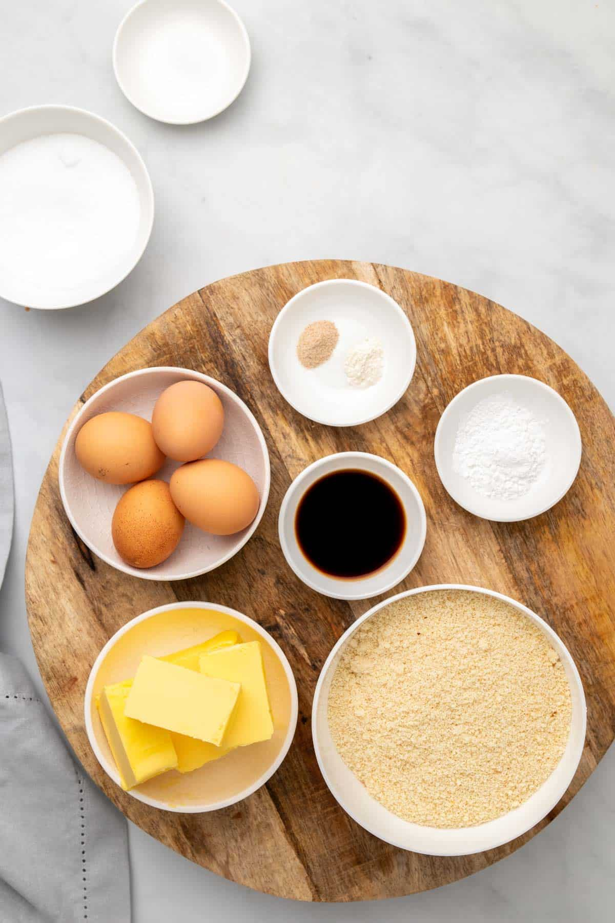Pound cake ingredients in separate ramekins as seen from above