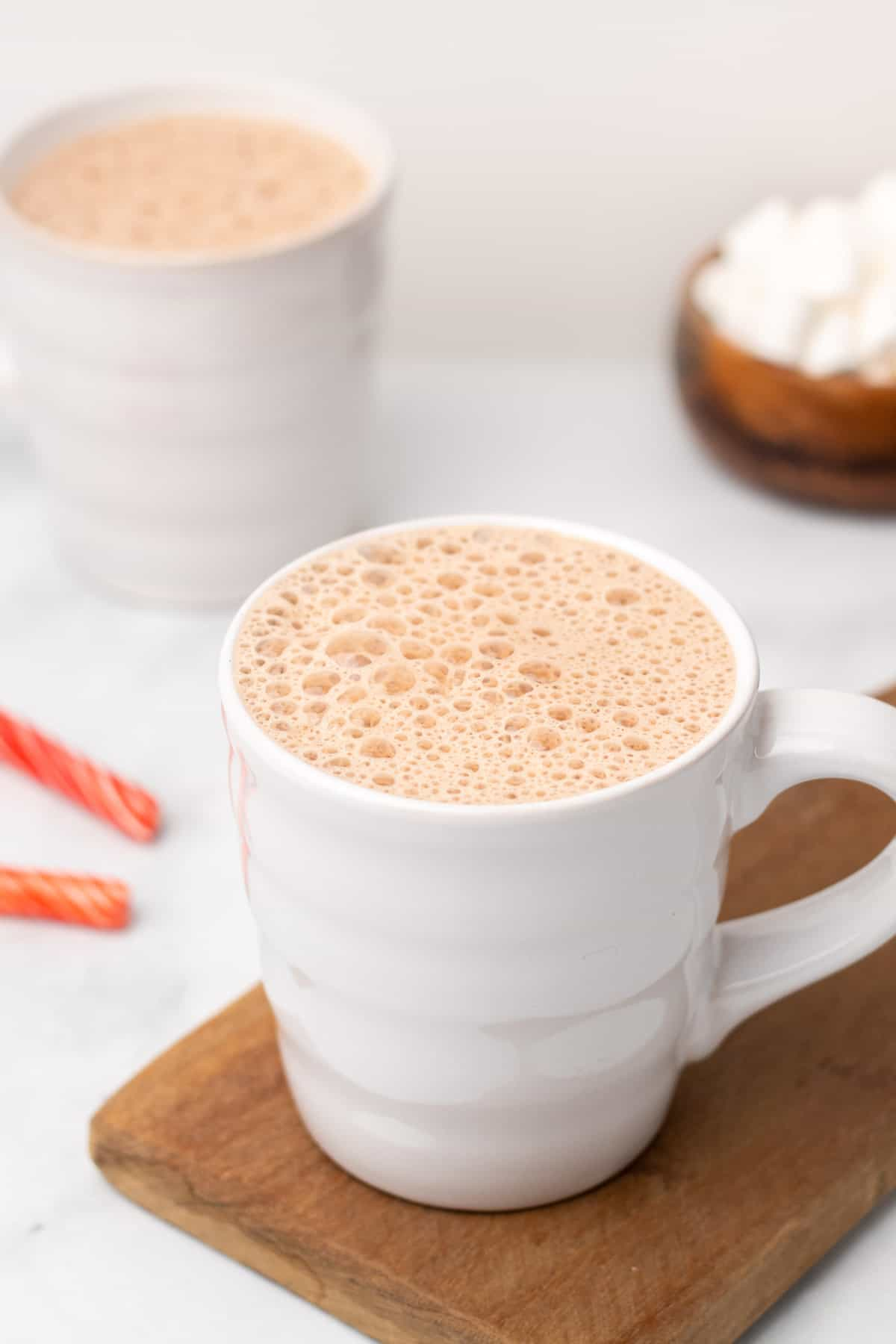 Peppermint mocha latte in a white coffee mug