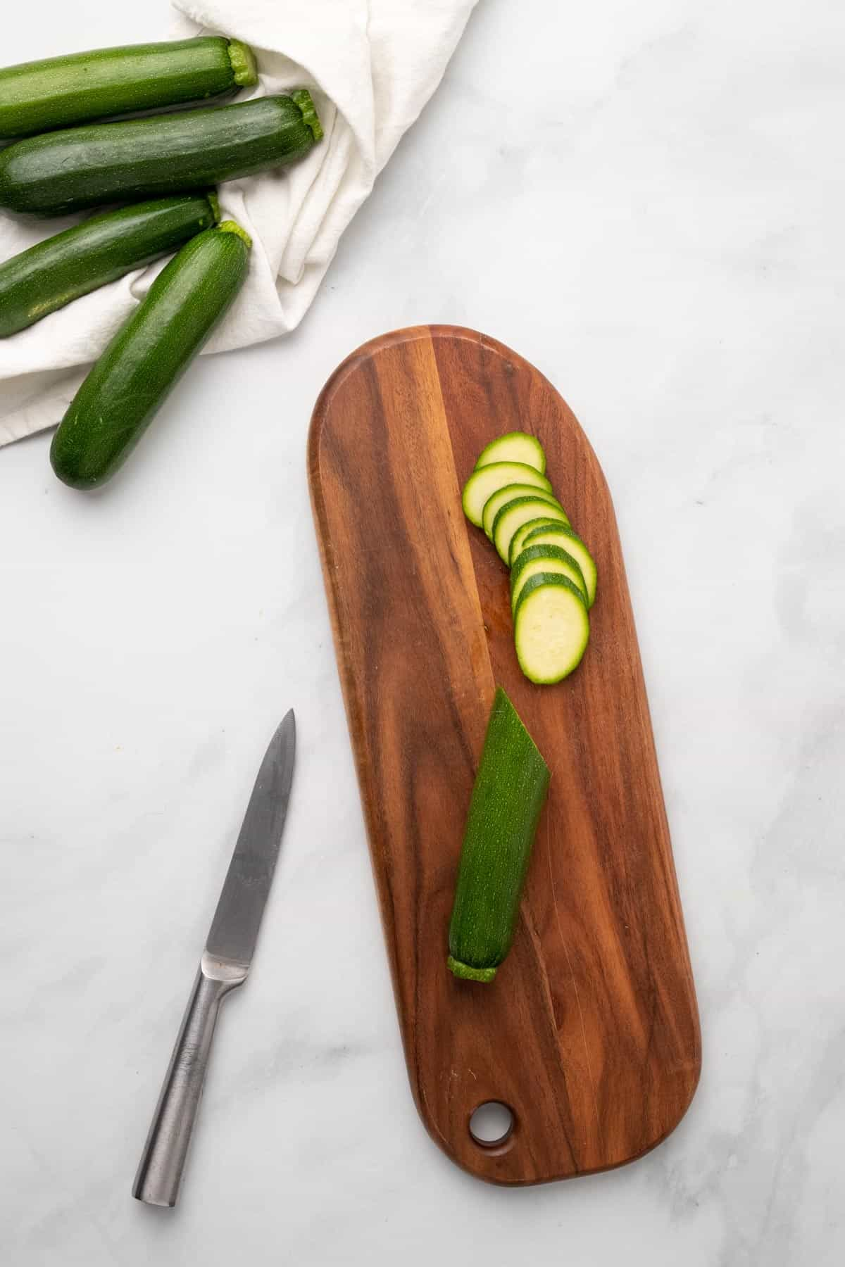 Thinly sliced zucchini on a board