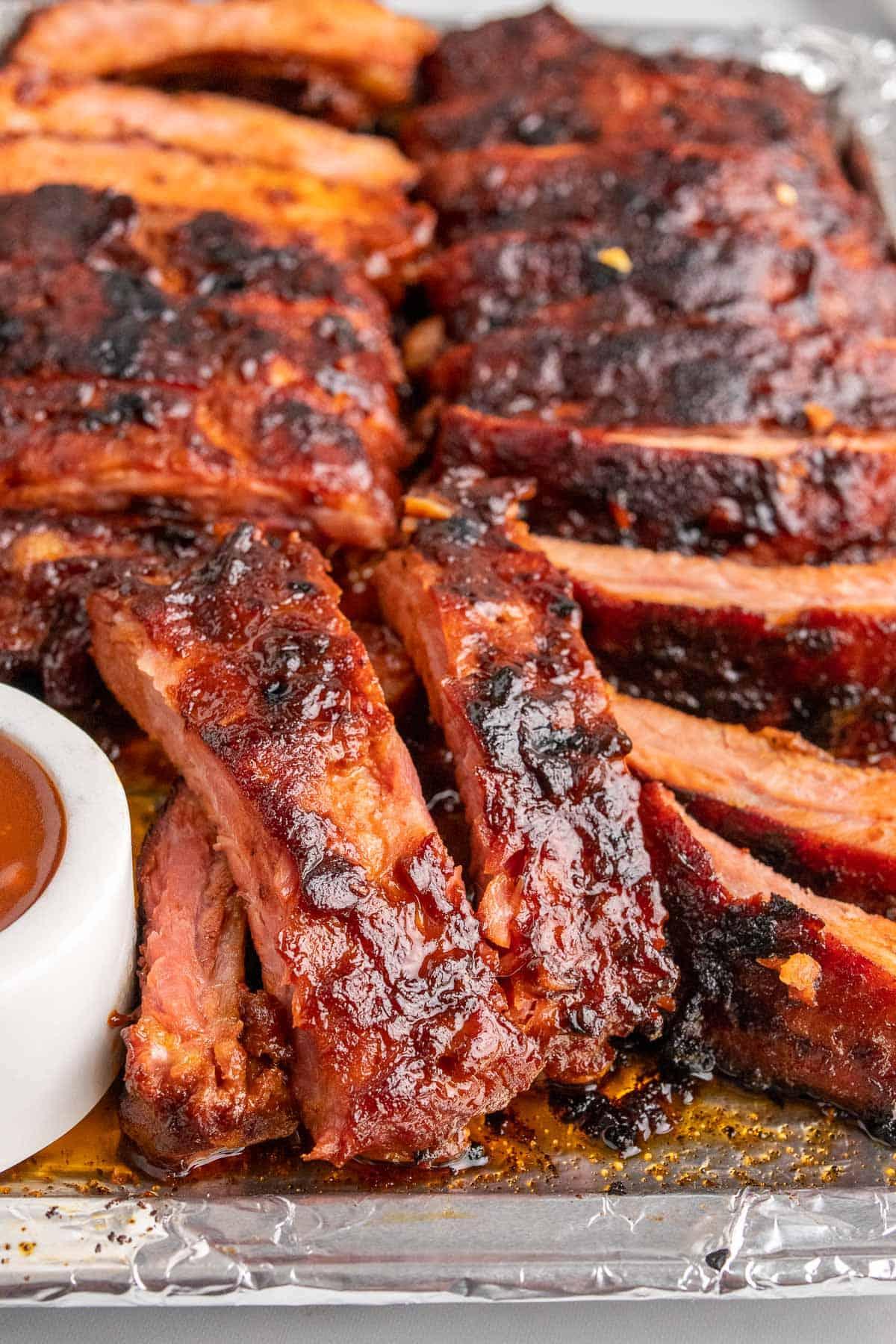 Closeup of sliced ribs on a baking sheet