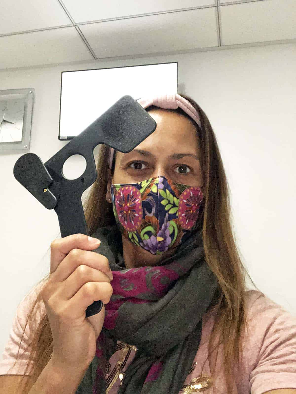 Christel holding a mask for the visual acuity test