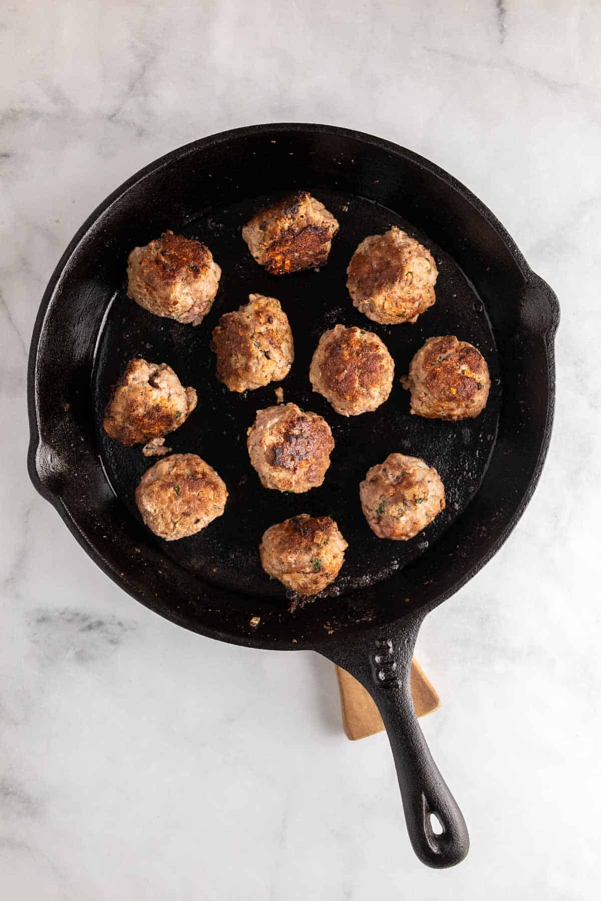 Cooked meatballs in cast iron skillet