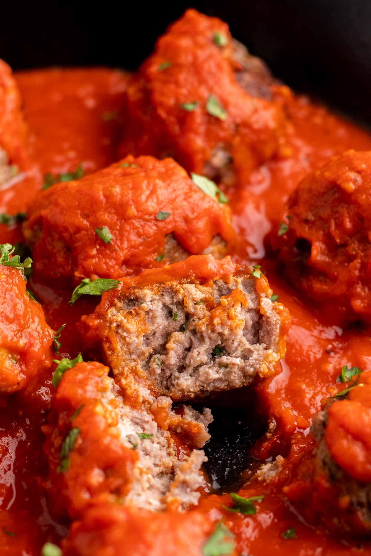 Close-up of meatballs with one cut in half