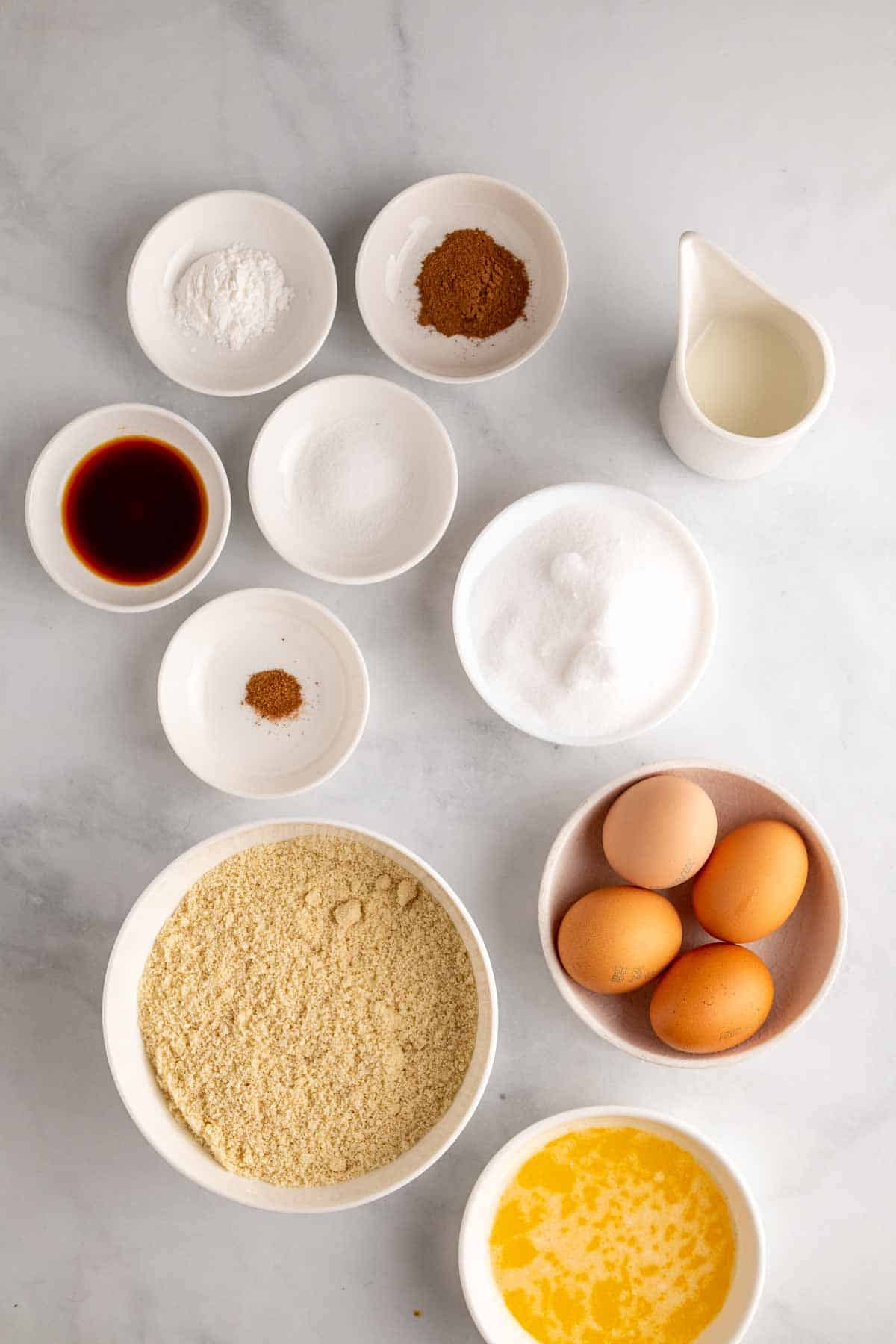 Donut ingredients in separate ramekins, as seen from above