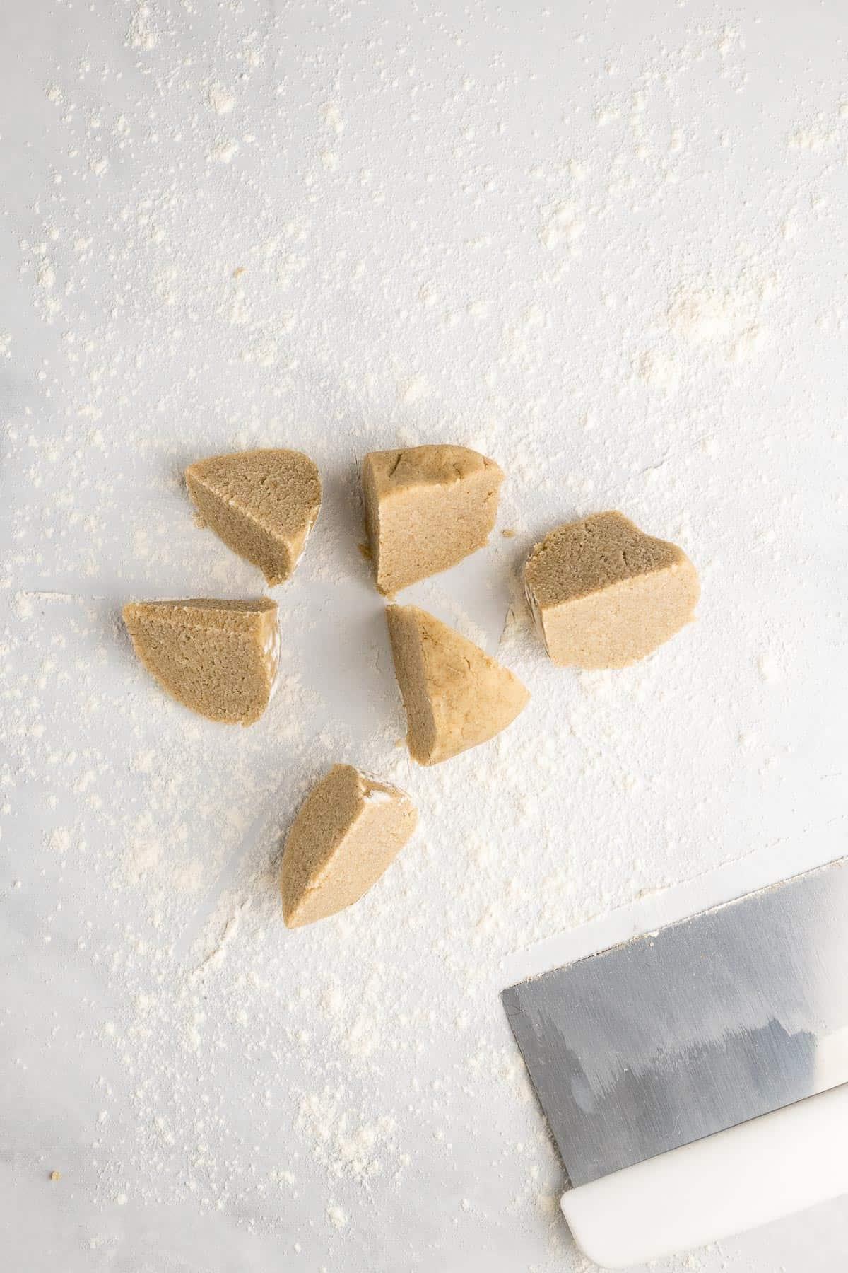 Dough ball cut into six equal pieces
