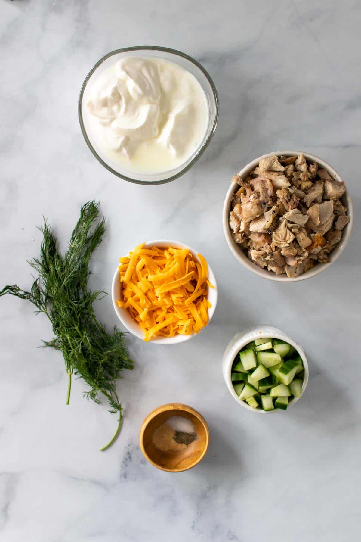 Ingredients for recipe separated into different bowls, as seen from above