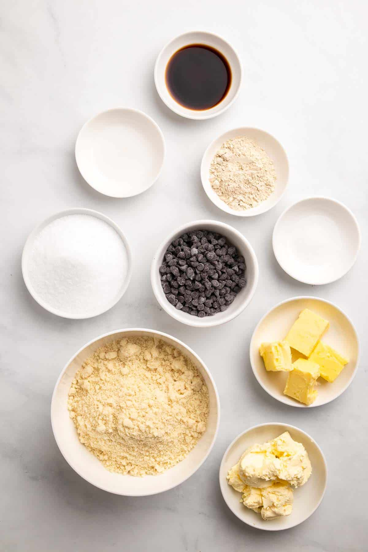 Ingredients for cookie dough separated into individual bowls and ramekins