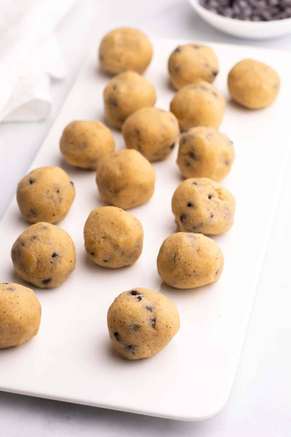 Cookie dough balls on a white serving tray
