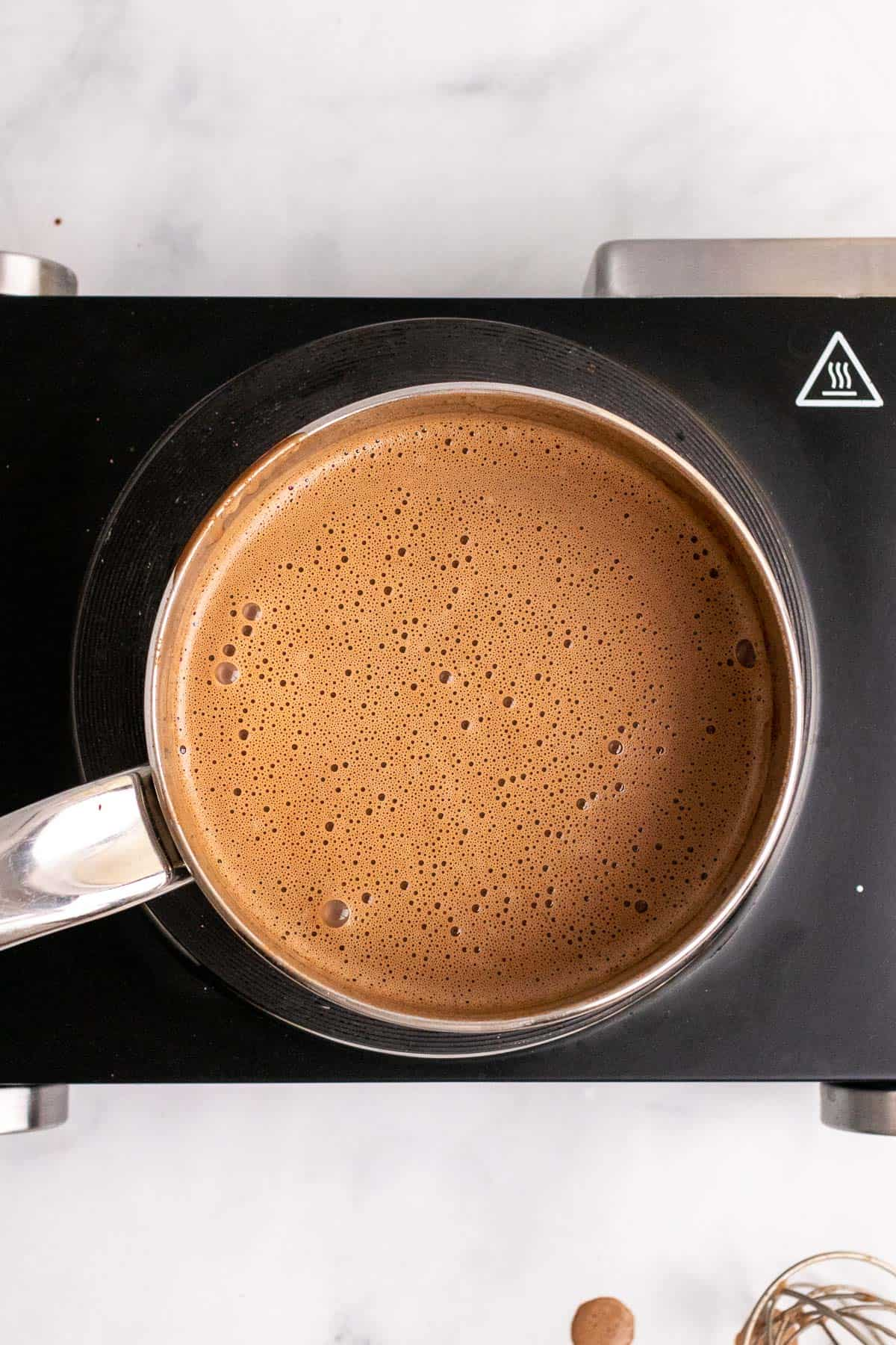 Steam hot chocolate in the saucepan, ready to serve