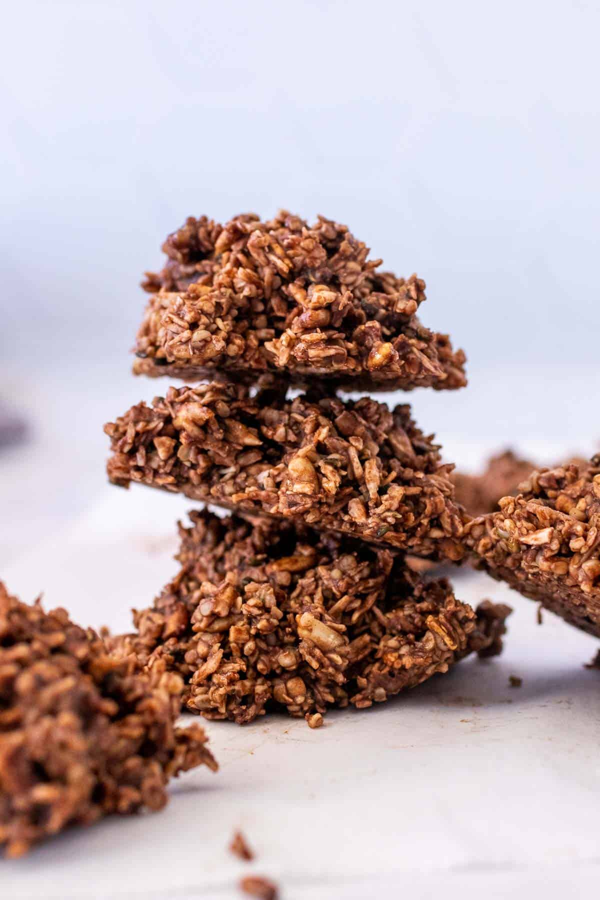 Stack of three keto no bake cookies surrounded by more cookies