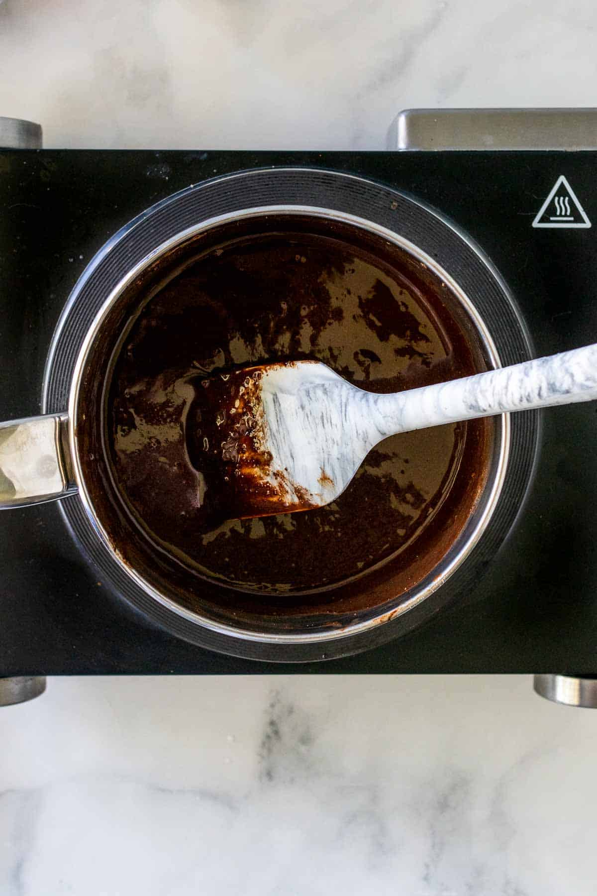 Ingredients stirred in a saucepan with a spatula until melted and smooth