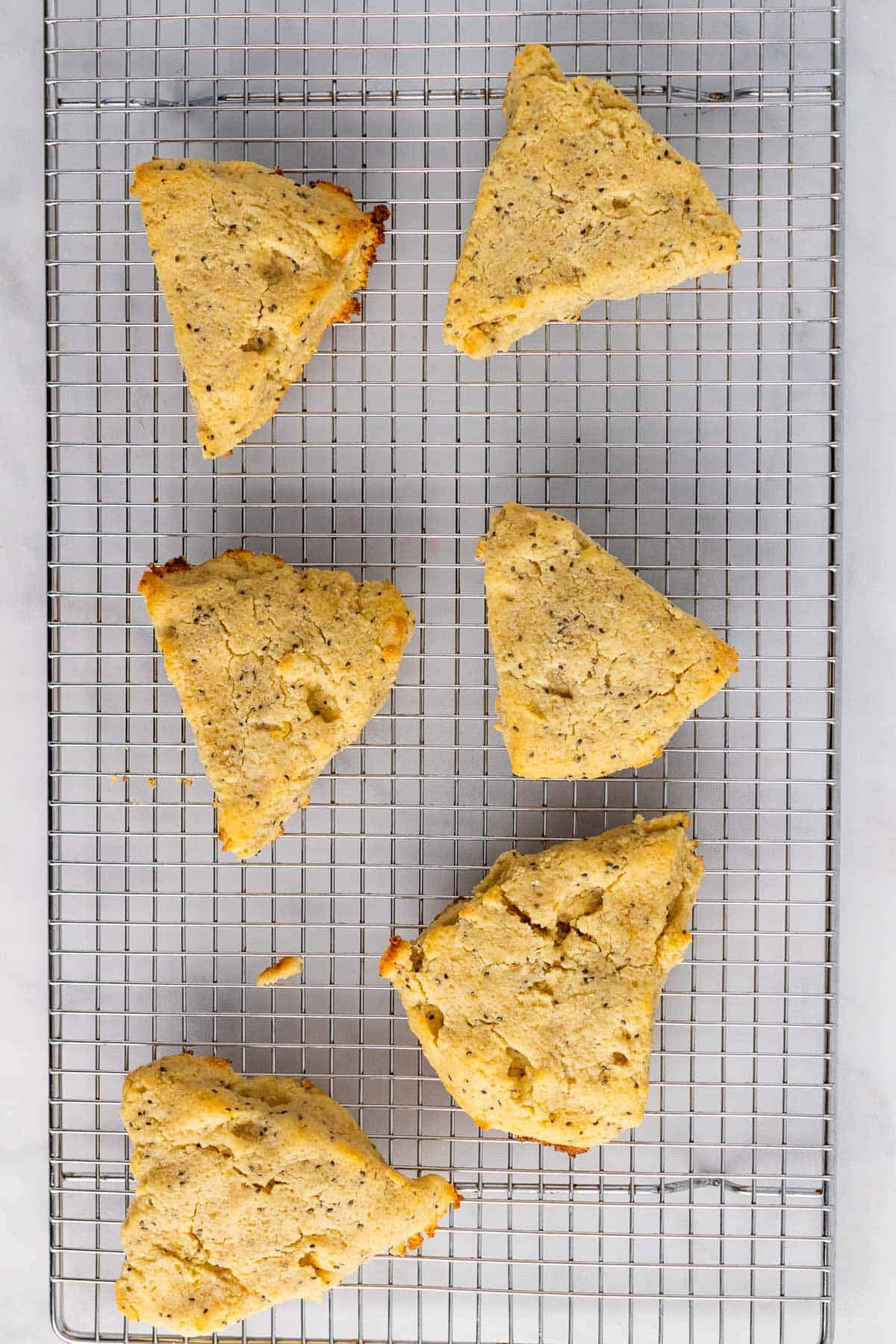 Six scones cooling on a wire rack, as seen from above