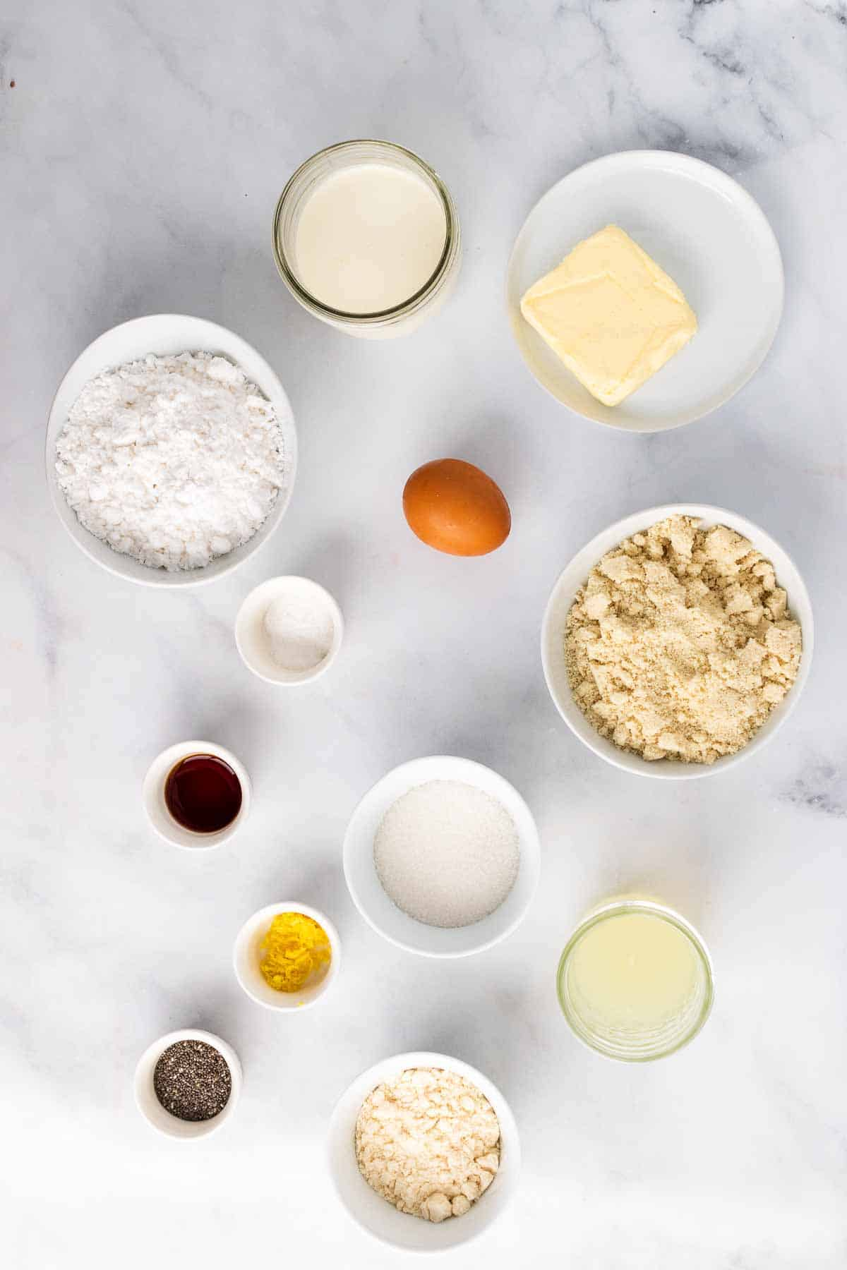 Ingredients for recipe in separate bowls and ramekins, as seen from above