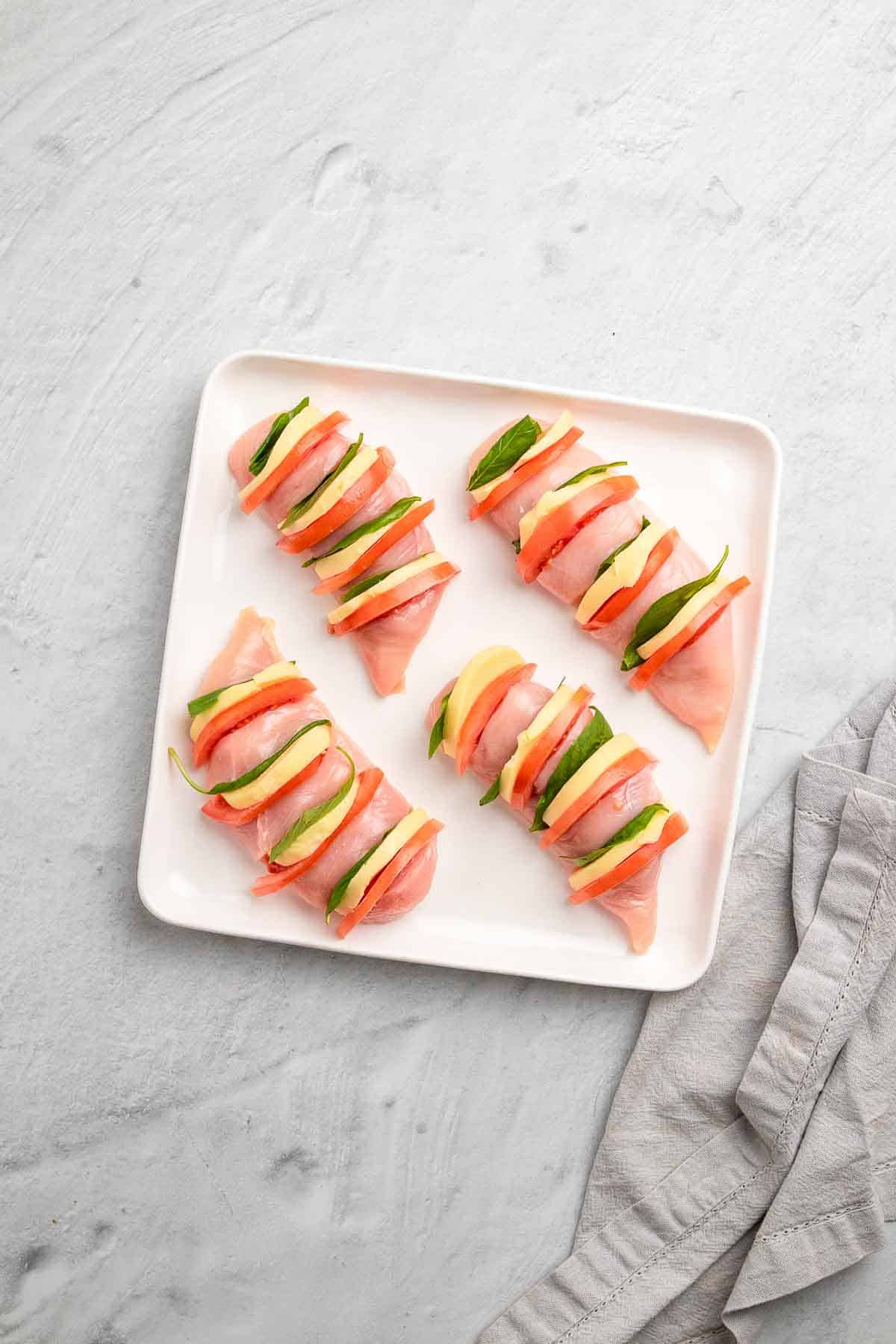 Sliced chicken breasts stuffed with mozzarella, tomato, and basil