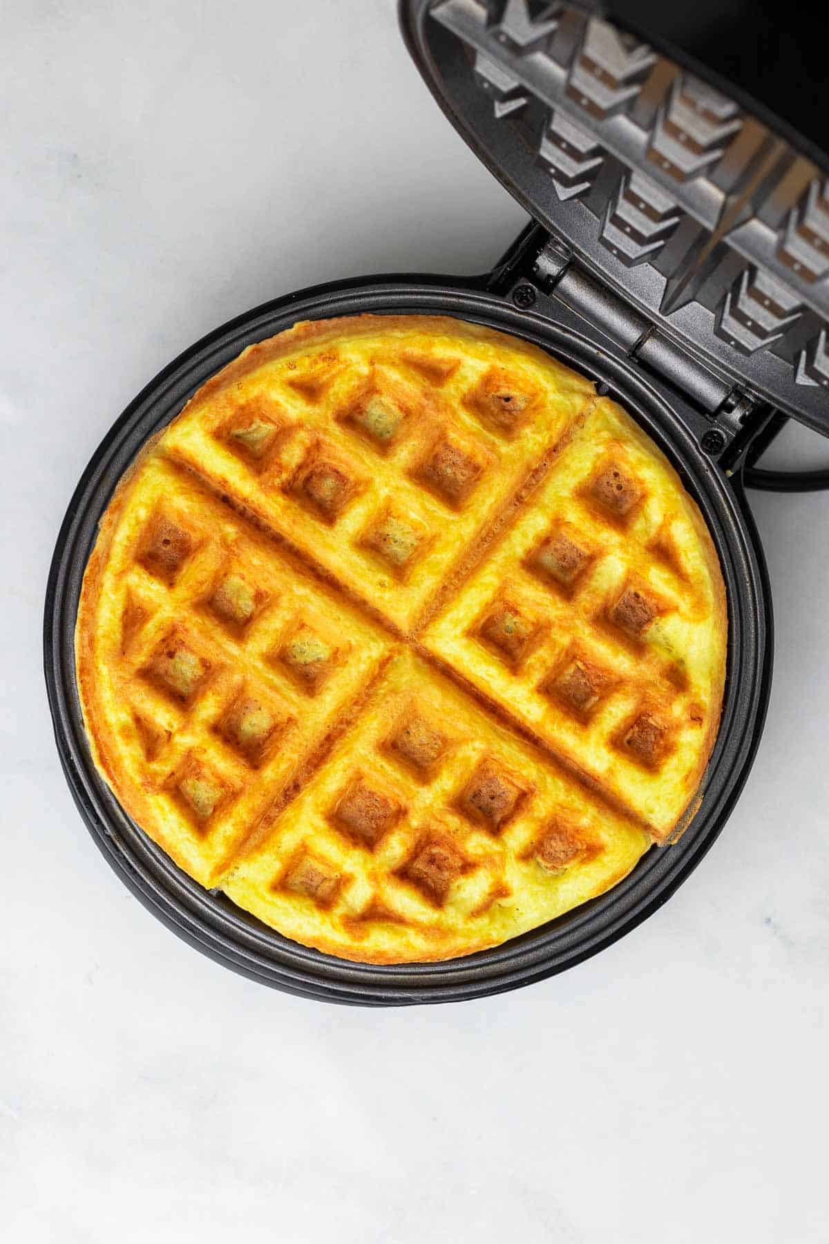 Finished chaffle in the waffle maker, as seen from above
