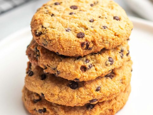 Stack of four Cream Cheese Chocolate Chip Cookies on a white plate