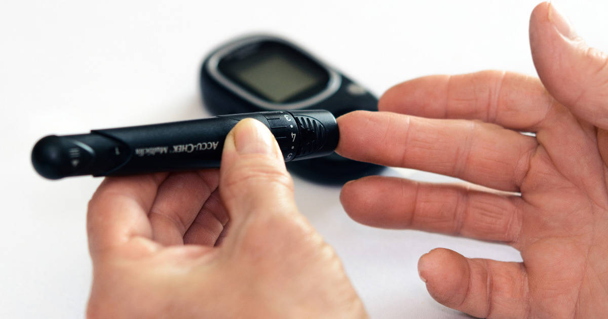 Hands testing blood sugar with a glucometer